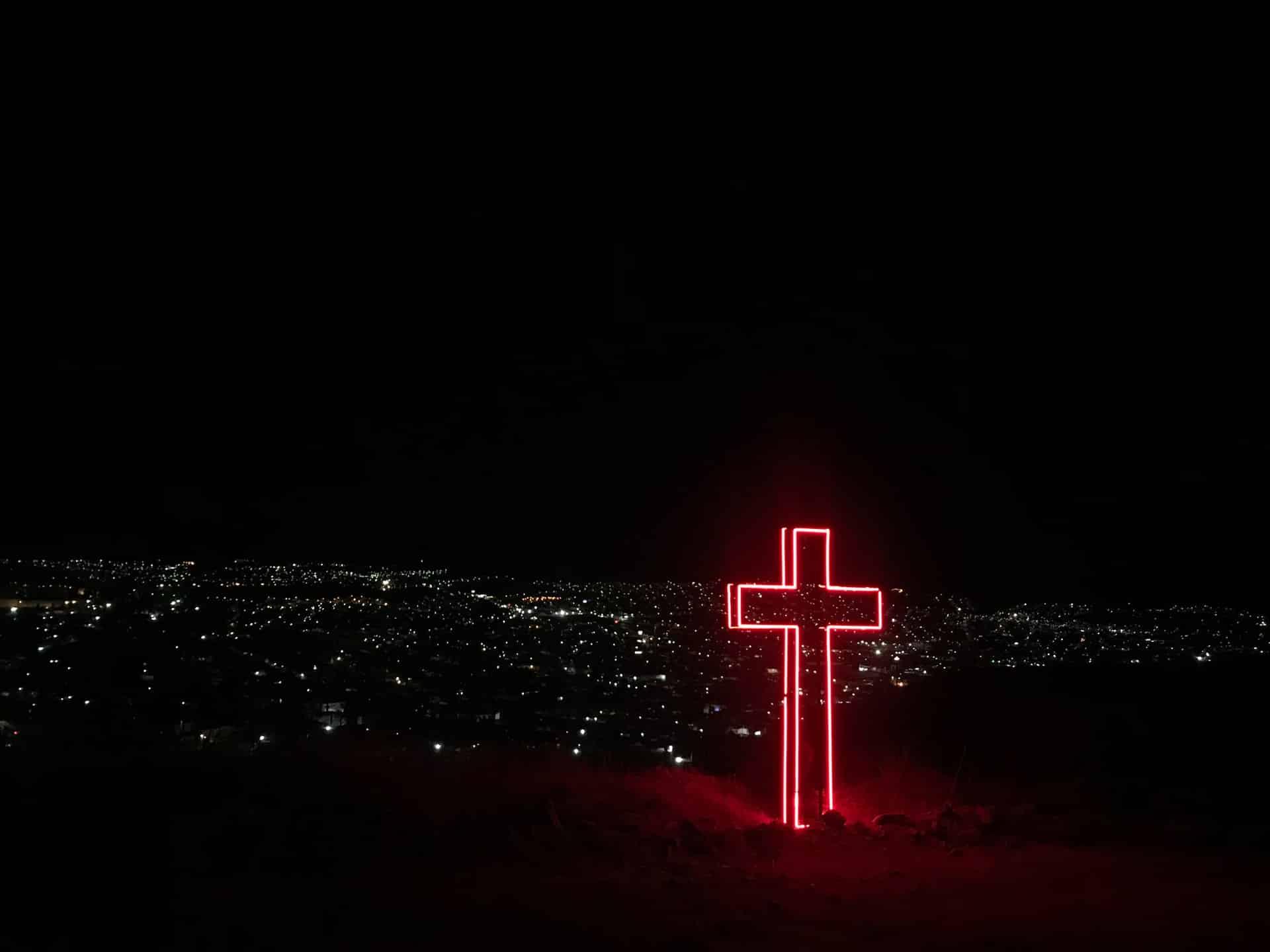 big red neon cross